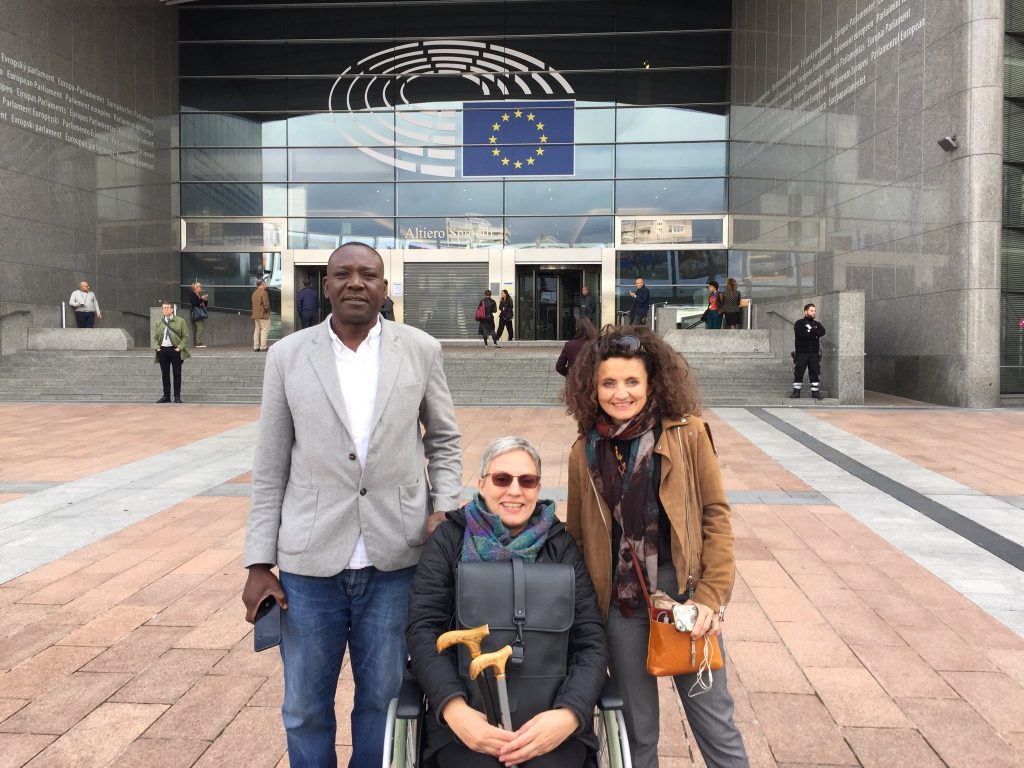 Haringey Welcome members and MEPS in front of European Parliament.